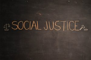 Illustration that says social justice for the Choosing To Be A Socially Just Educational Leader Fireside Chat