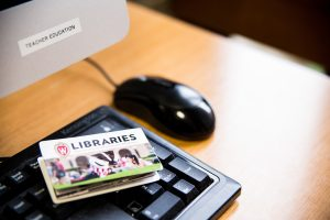 library cards sitting on a computer keyboard