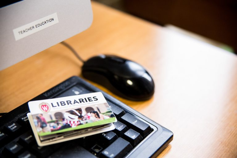 photo of keyboard and mouse with UW Libraries brochure
